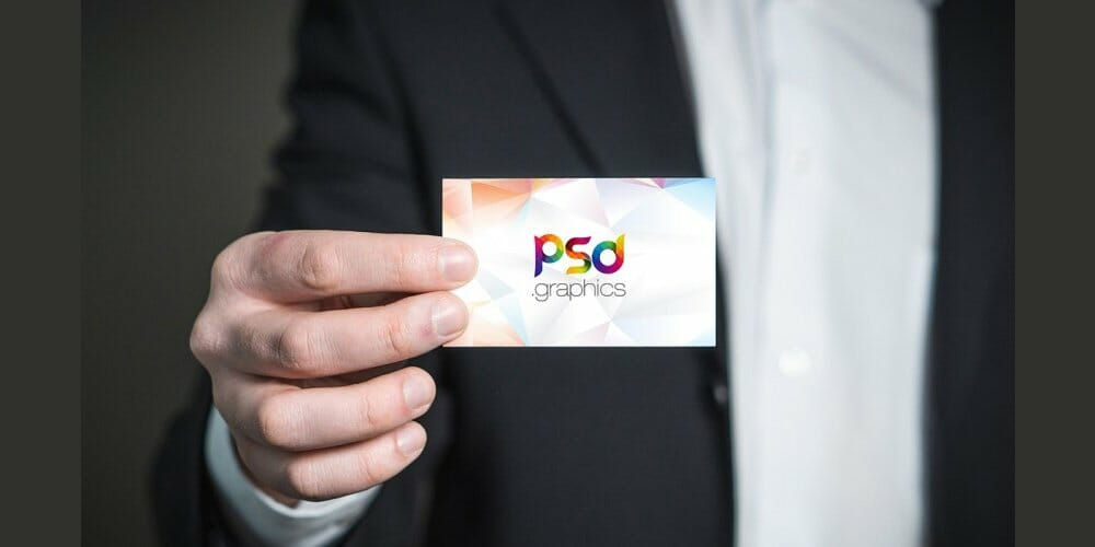 Business Card Holding in Hand Mockup PSD