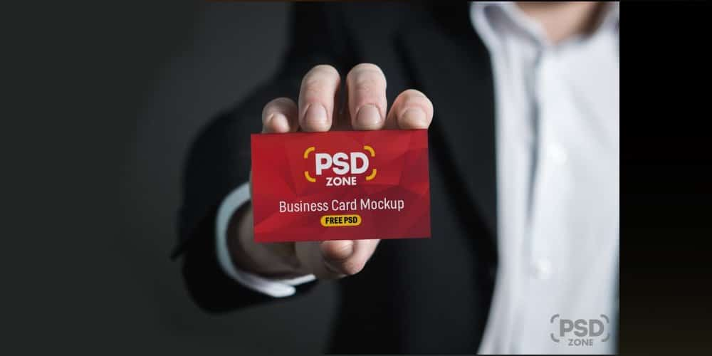 Business Card in Hand Mockup PSD