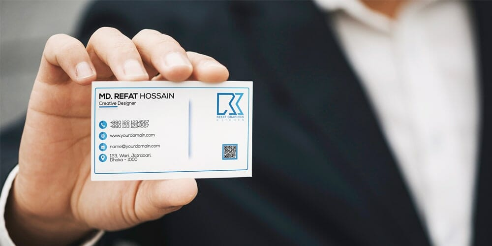 Man Hold Business Card Mockup PSD
