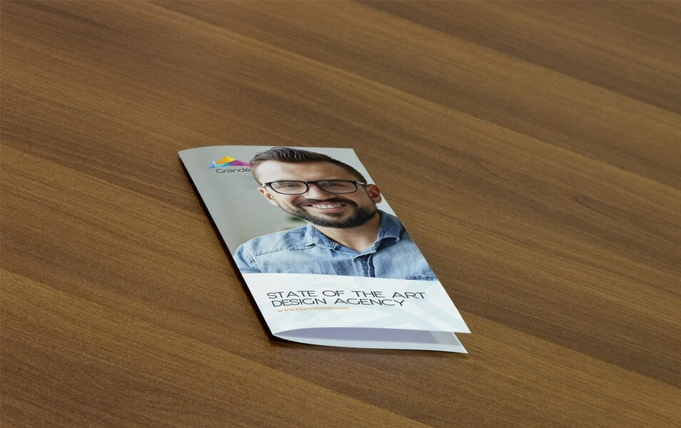Free Photorealistic PSD Mockup of Bifold Flyer
