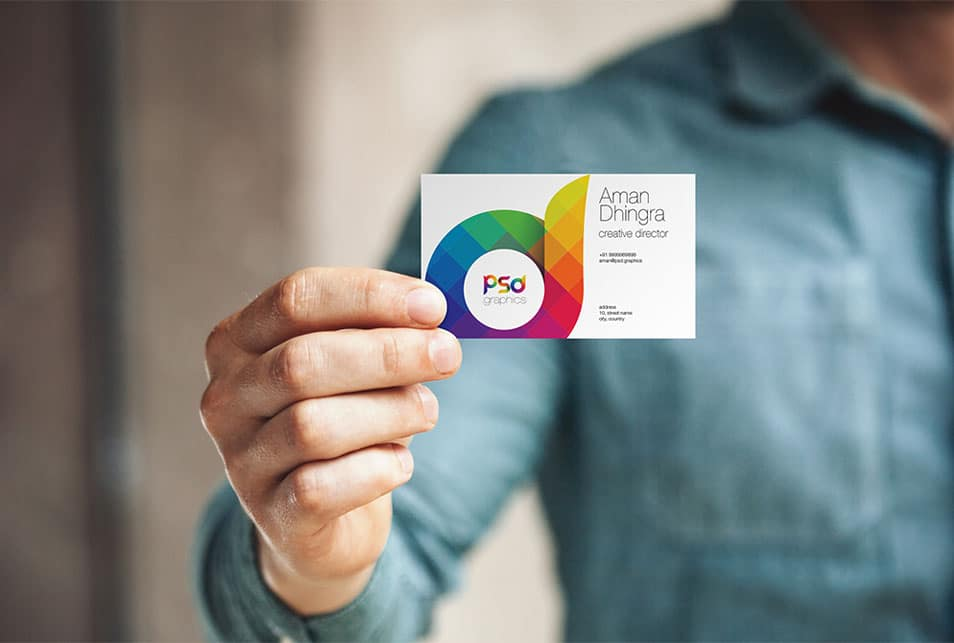 Man Holding Business Card Mockup PSD