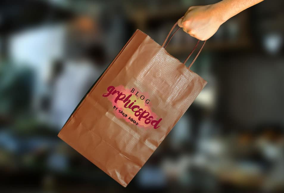 Hand Holding Paper Bag Free Mockup PSD